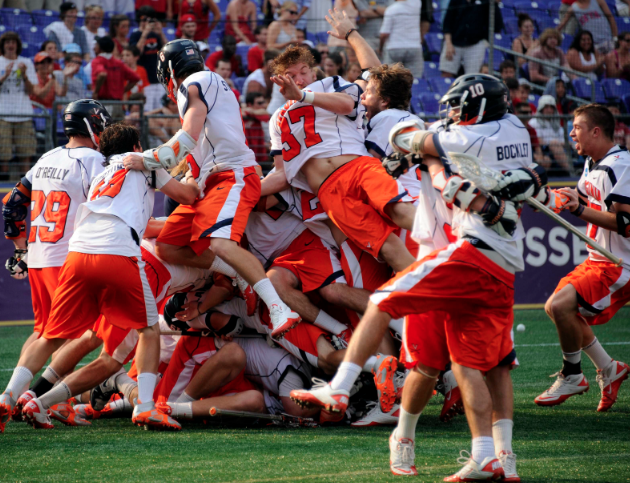 May 30, 2011; Baltimore, MD, USA; Members of the Virginia Cavaliers jump into a pile after defeating the Maryland Terrapins in the NCAA Division I Men's lacrosse national championship game at M&T Bank Stadium. Mandatory Credit: Rafael Suanes-US PRESSWIRE