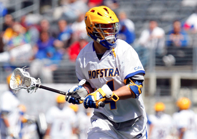 Apr 10, 2010; East Rutherford, NJ, USA; Hofstra Pride attack Kevin Ford (4) brings the ball up field against the Delaware Blue Hens at the Big City Classic at the New Meadowlands Stadium. Mandatory Credit: Jim O'Connor-USA TODAY Sports