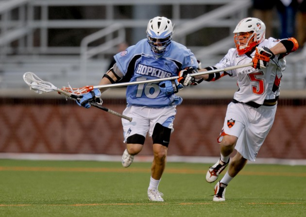 Mar 2, 2012; Princeton, NJ, USA; John Hopkins Blue Jays midfielder Lee Coppersmith (16) works against Princeton Tigers defender Derick Raabe (5) at Princeton. Mandatory Credit: Jim O'Connor-USA TODAY Sports