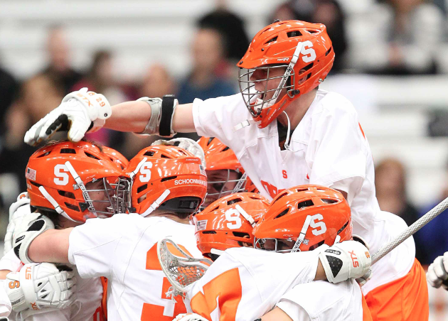 Feb. 26, 2012; Syracuse Orange, NY: Syracuse Orange players celebrate a win over Army Black Knights. The Syracuse Orange beat the Army Black Knights 10-9 at the Carrier Dome. Mandatory Credit: Danny Wild-USA TODAY Sports