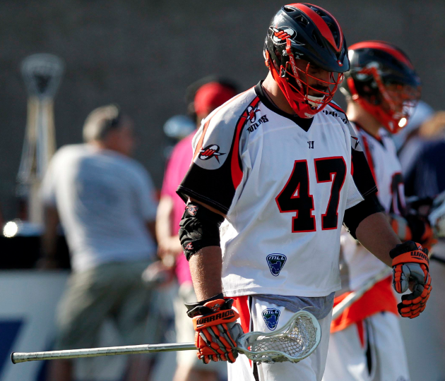 Aug 26, 2012; Allston, MA, USA; Denver Outlaws midfielder Anthony Kelly (47) hangs his head in the final minutes of the game against the Chesapeake Bayhawks at Harvard Stadium. The Chesapeake Bayhawks won 16-6. Mandatory Credit: Greg M. Cooper-USA TODAY Sports
