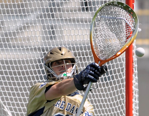 May 20, 2012; Chester, PA USA; Notre Dame Fighting Irish goalie John Kemp (1) makes a save against the Virginia Cavaliers during the second half of the NCAA Division I Men's Lacrosse Quarterfinals at PPL Park. The Fighting Irish won 12-10. Mandatory Credit: Eric Hartline-US PRESSWIRE