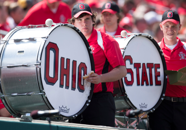 Apr 13, 2013; Cincinnati, OH, USA; Members of the Ohio State Buckeyes spring band grab a snack during the second half of the Ohio State Buckeyes spring game at Paul Brown Stadium. The Scarlet team won 31-14. Mandatory Credit: Greg Bartram-USA TODAY Sports